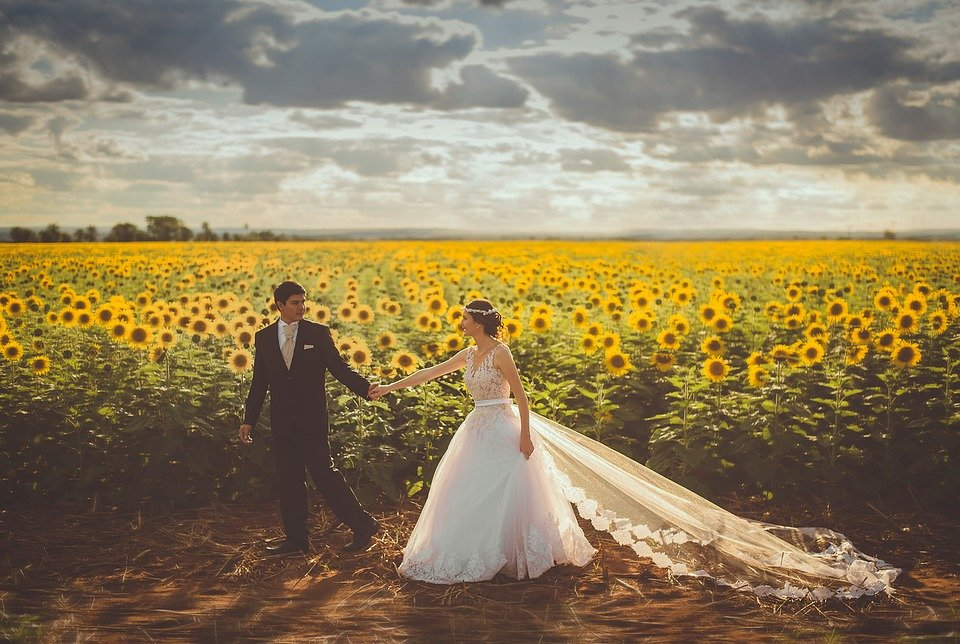 Christian couple in a field of sunflowers