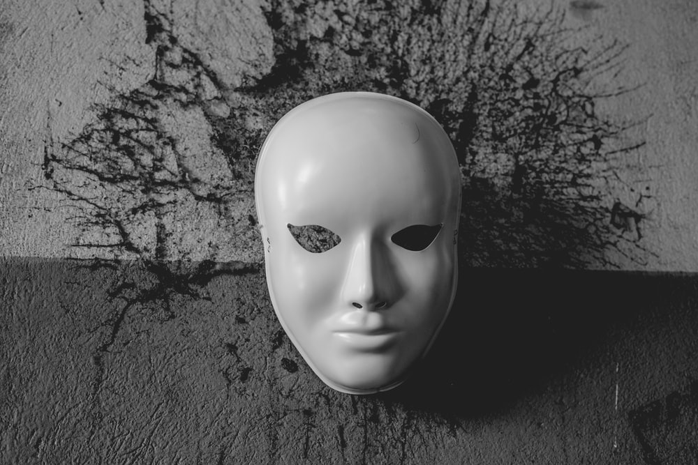 a sinister looking mask, signifying deception